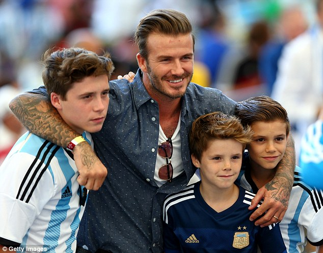 David, with his sons Brooklyn (left), Cruz (centre) and Romeo (right) in Brazil, in July 2013. One suggestion is that the couple could move the whole family back to Los Angeles in an attempt to rekindle their marriage
