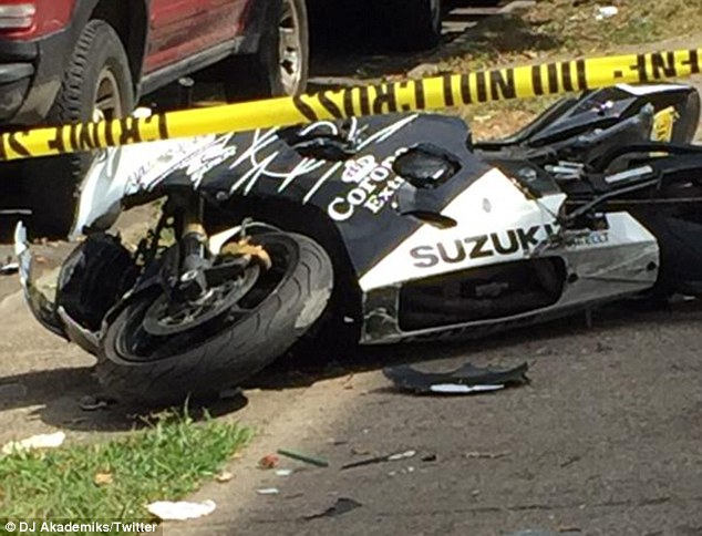Down:The Trap Queen singer's black-and-white Suzuki bike was seen on the ground with a shattered front end and pieces of the exterior scattered about the road