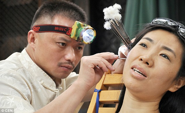 Chinas earcleaning masters who remove peoples earwax
