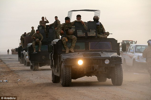 Iraqi Kurdish Peshmerga forces enter a village as they capture the area after staging an operation in Kirkuk