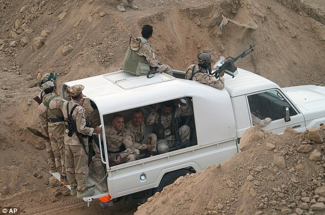 Kurdish troops prepare to attack Islamic State group positions during a military operation west of Kirkuk