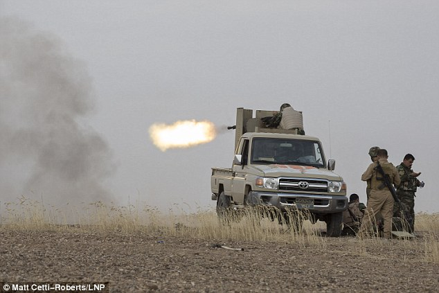 Kurdish peshmerga fighters fire a heavy machine gun into the village of Mansoria during an offensive aimed at capturing 11 villages from the Islamic State near Kirkuk. The operation was backed by the U.S.-led coalition