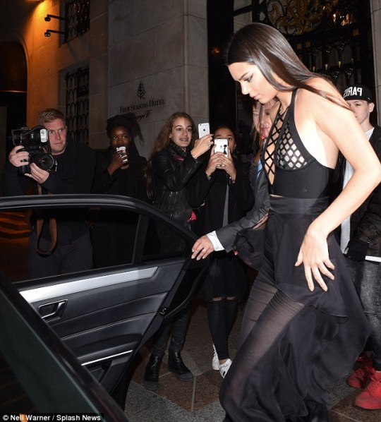 Make way: She quickly scurried into her car before heading to acocktail party in Paris