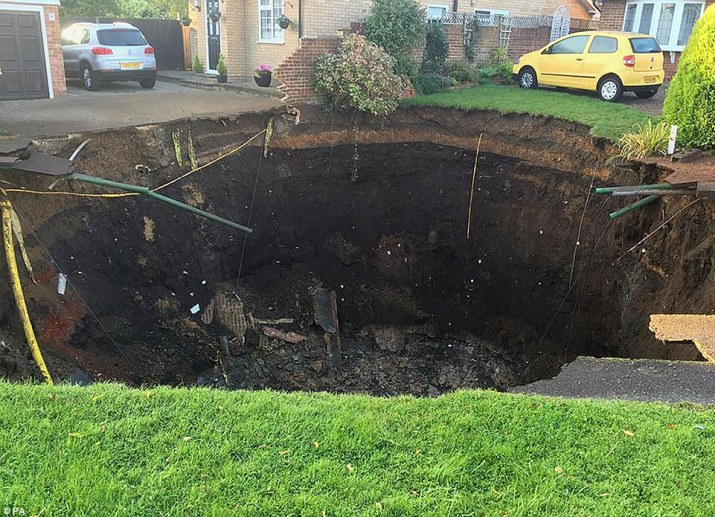 Residents have been evacuated from their homes after a sinkhole the size of two houses opened up in a suburban street in Hertfordshire