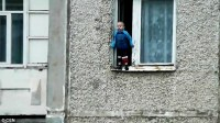 Russian toddler balances on the ledge of an eighth floor
