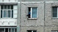 Russian toddler balances on the ledge of an eighth floor ...