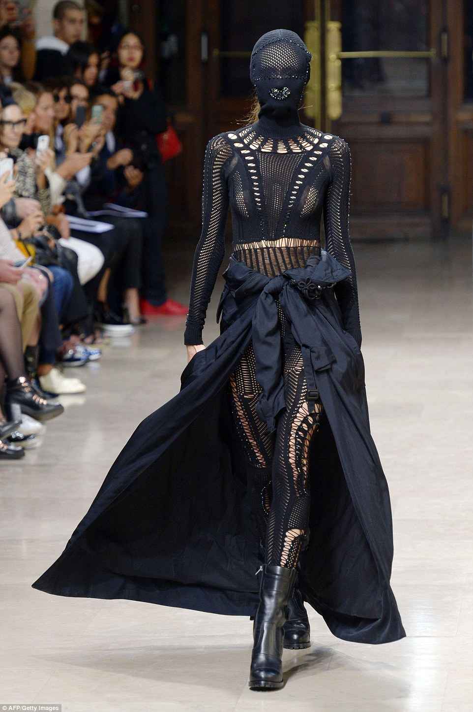 One model turned heads in an all-in-one black crocheted jumpsuit. The attention-grabbing outfit featured a knitted mask with studs in the shape of a pair of lips