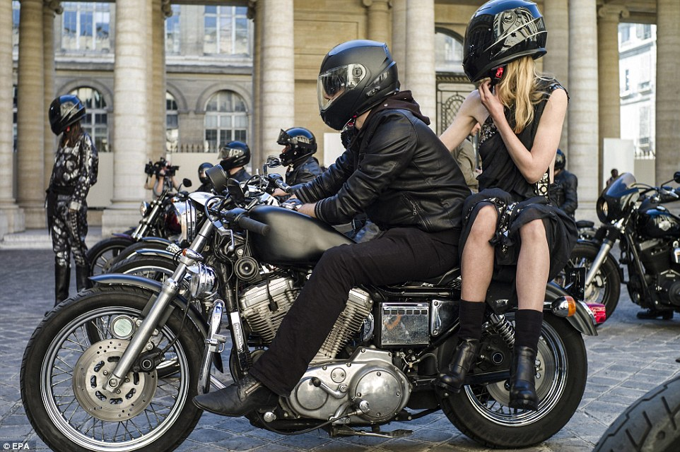 Hinting that the presentation would be a nod to gothic bikers before it began, models caused a scene by arriving on the back of vintage motorcycles