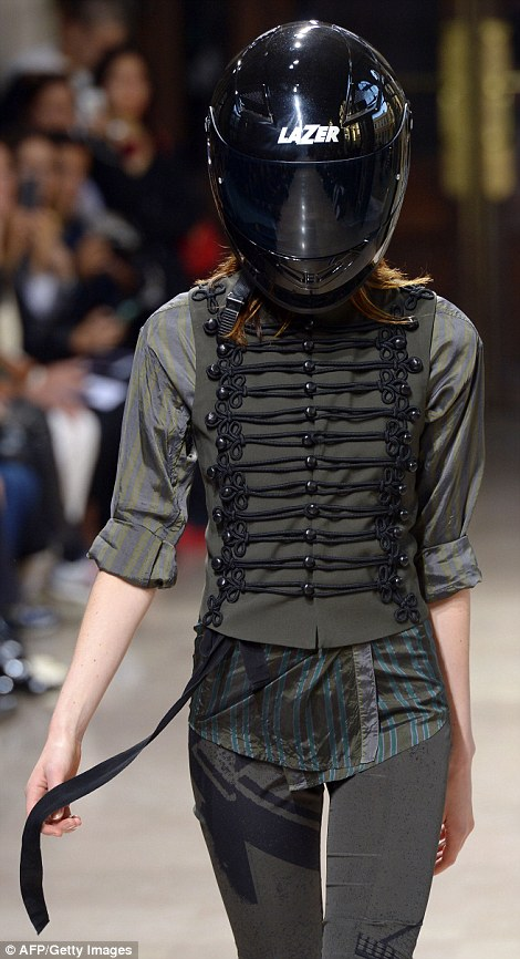 This model turned heads in a motorcycle helmet and a khaki military-style jacket
