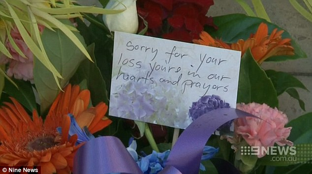 Floral tributes have been left to Mr Cheng outside the police headquarters in Parramatta, Sydney