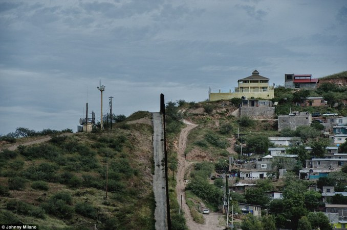 The line: Led by the group's chief 'Nailer' - the band of brothers protect the border near the Mexican town of Nogales. Pictured, America, left, and Mexico, right