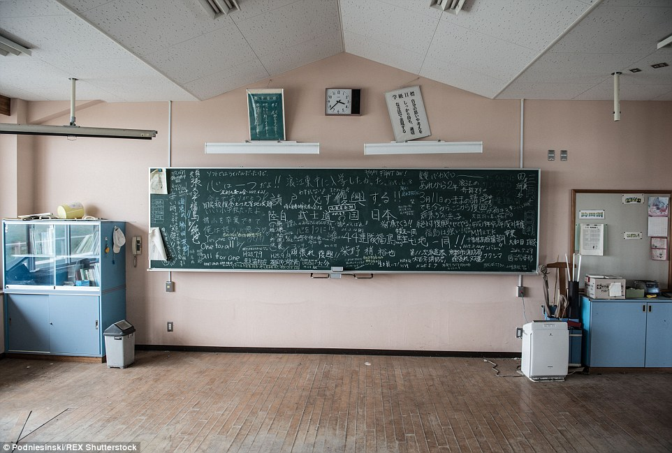A classroom blackboard still displays the scribbles of what children were learning the moment the earthquake struck