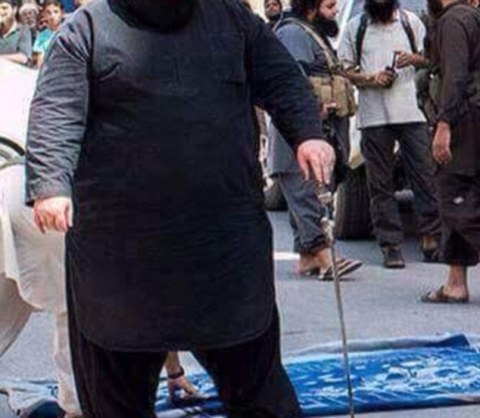 Monster: The Bulldozer's massive frame cuts an easily recognisable figure among the public in Iraq