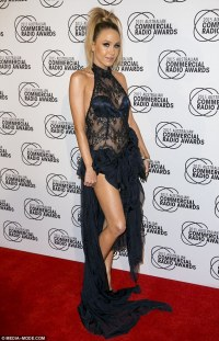 Imogen Anthony dons a thigh-high split gown with Kyle ...