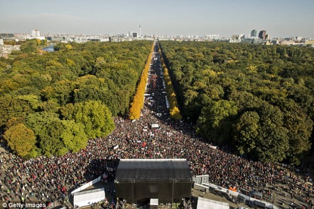 Huge crowds: Demonstrators flooded the streets of Berlin today in protest against the proposed Trans-Pacific Trade and Investment Partnership, which would knock down trade regulations between the U.S. and EU