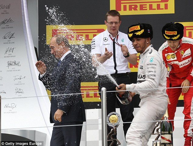 Formula One driver Lewis Hamilton has celebrated his victory today at the Sochi Grand Prix by spraying Russian President Vladimir Putin with champagne on the winners' podium