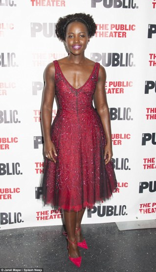 Bright spark: The Oscar winner wore a red gown with pretty tulle skirt