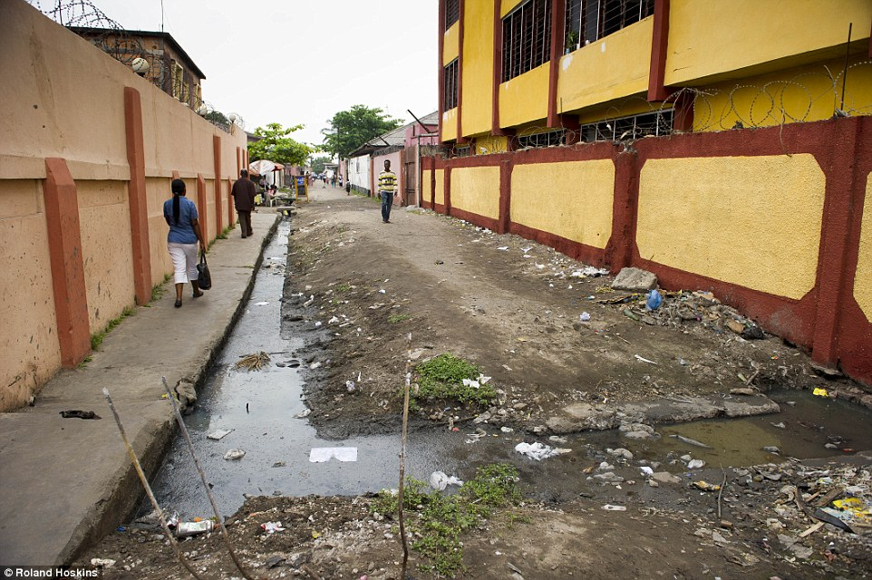Aim: Ending poverty is the number one goal of the UN's new sustainable development goals. Doing this one thing would go a huge way to ending the culture of 'witchcraft' in the DRC, and across central Africa. Pictured: A street in Kinshasa, where one of the shelters is located