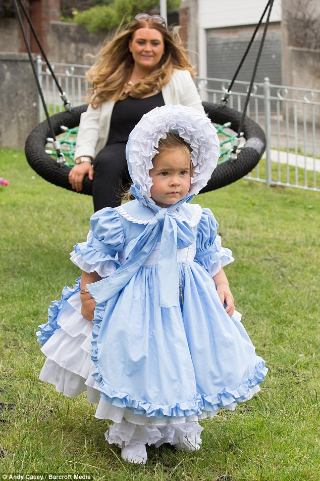 Minnie-Beau at a play area in her designer outfit and bonnet