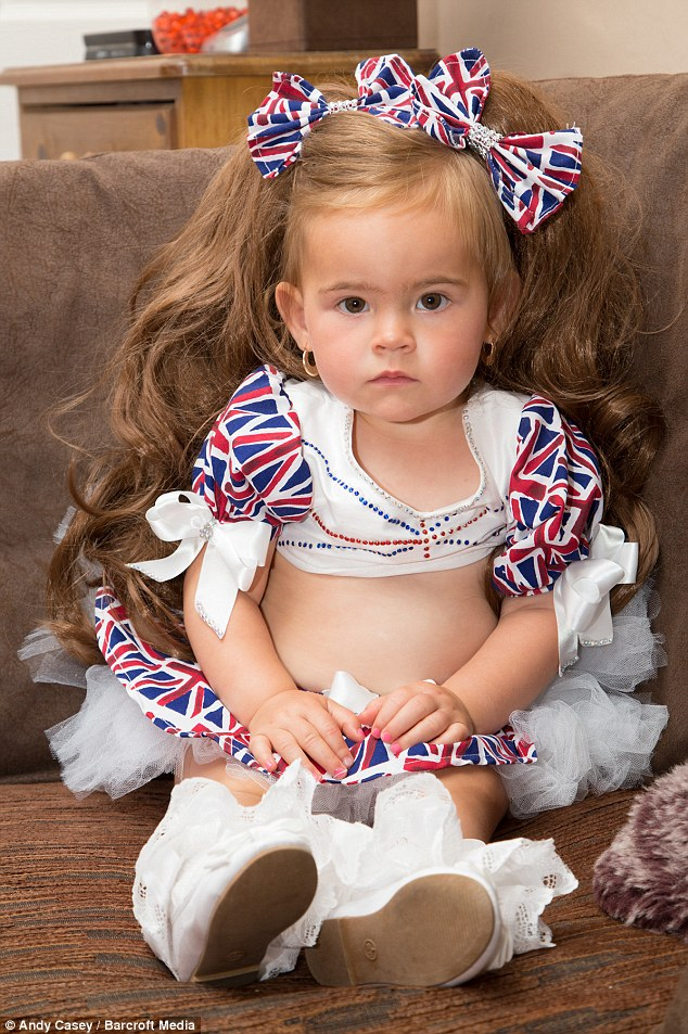 Minnie-Beau in a Union Jack two-piece and a wig which she competed in at her first pageant
