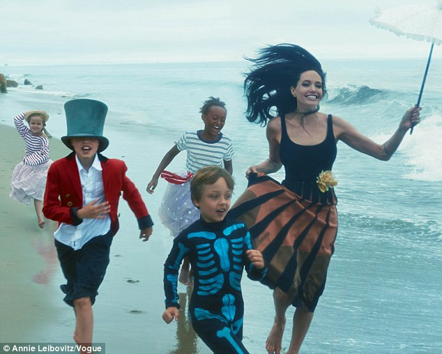 Gorgeous family: Angelina Jolie poses with husband Brad Pitt and her six children in the November issue of Vogue magazine. (L-R) Vivienne, Shiloh, Zahara and Knox are pictured here with the star