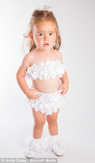 The toddler competed in a flower-petalled bikini, pictured, in one pageant but Jas says she is not sexualising her little girl