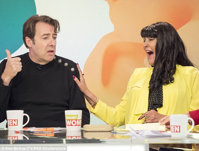 Having a laugh: The former Dragons' Den star is seen sharing a joke with Jonathan Ross on Loose Women