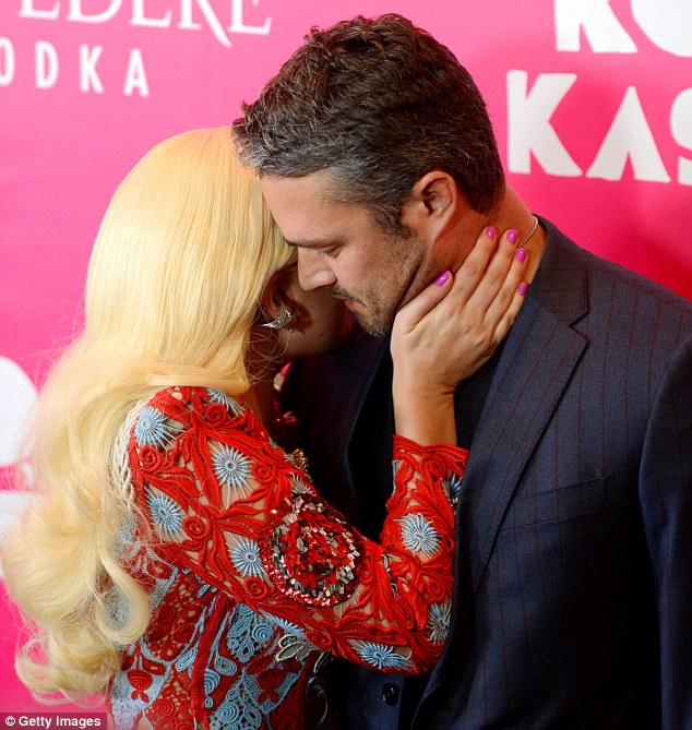 So touching: Gaga put a hand on her man's neck as she put her face close to his in front of the cameras