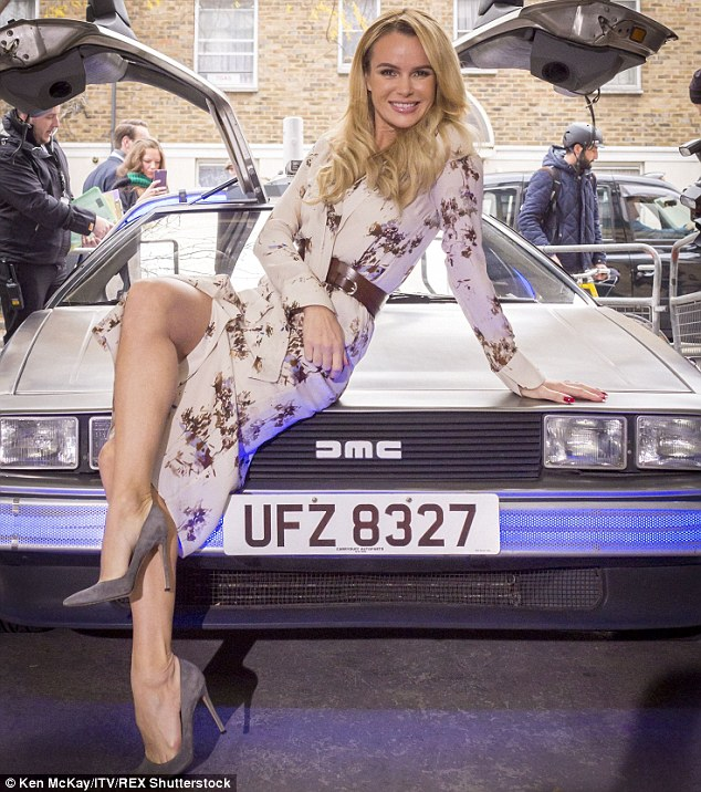 Amanda Holden Drapes Herself Over The Back To The Future