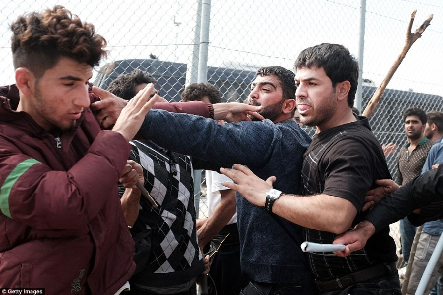 Punches thrown: Newly-arrived migrants were waiting to be processed at the increasingly overwhelmed Moria camp when tempers flared