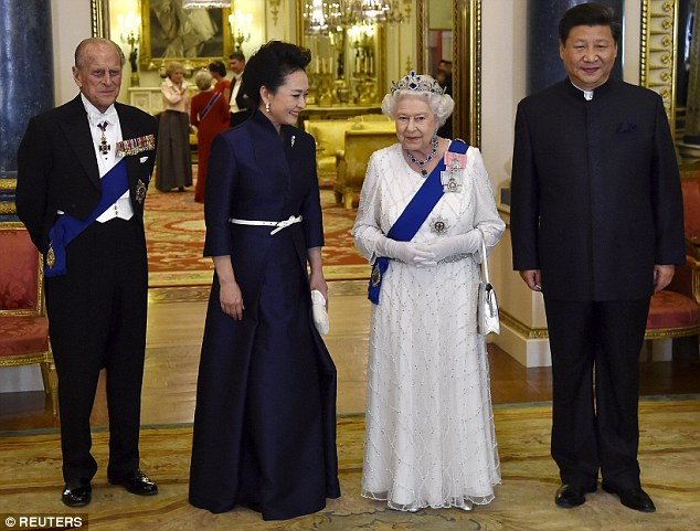 Xi Jinping and his wife Peng Liyuan accompany Britain's Queen Elizabeth and her husband Prince Philip as they arrive for the state dinner held tonight