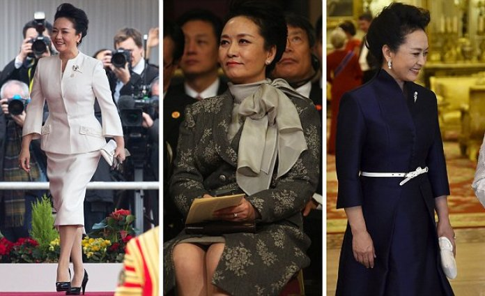 Peng Liyuan wears THREE outfits with husband Chinese President Xi Jinpingon first day of