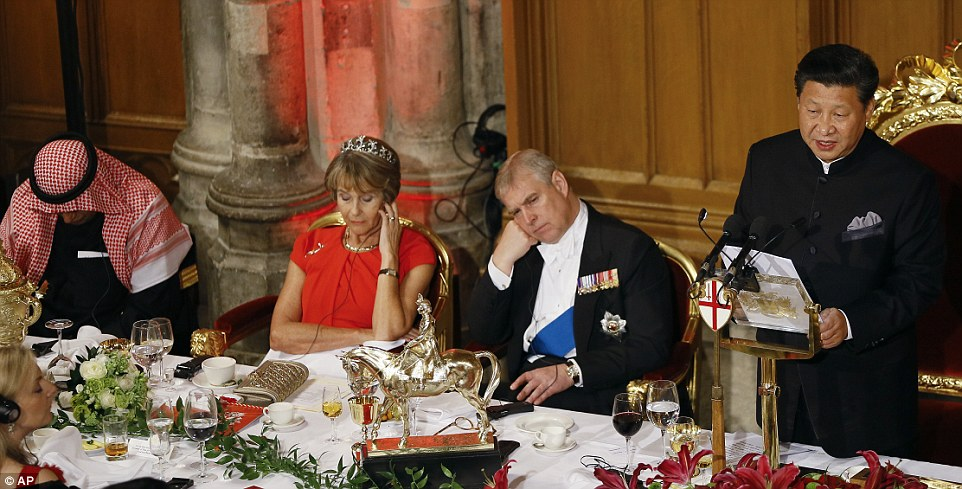 Prince Andrew and Lady Mayoress Gilly Yarrow appear less than enthused as they listen to a translated version of Mr Xi's speech tonight