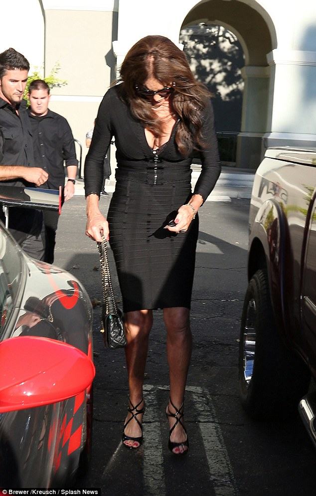 Well hello: Later on, Caitlyn Jenner showed up wearing a tight black dress and high heels