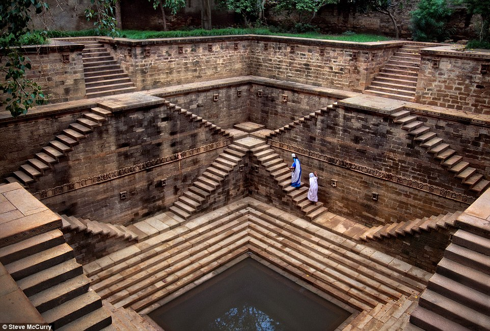 India, 2002. Women climb up mesmerizing stepwells. The magnificent underground structures were ancient forms of water storage and provide respite from the heat and temples