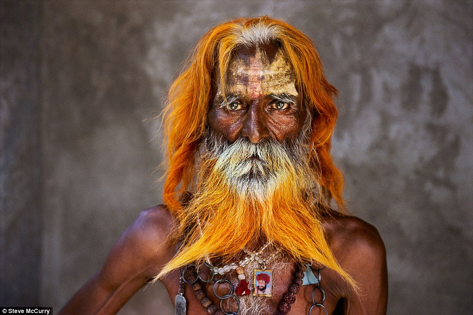 Rajasthan, 2010. A Rabari tribal elder stands out from the crowd with a distinctive orange-tinged beach and hair, adorned with numerous accessories