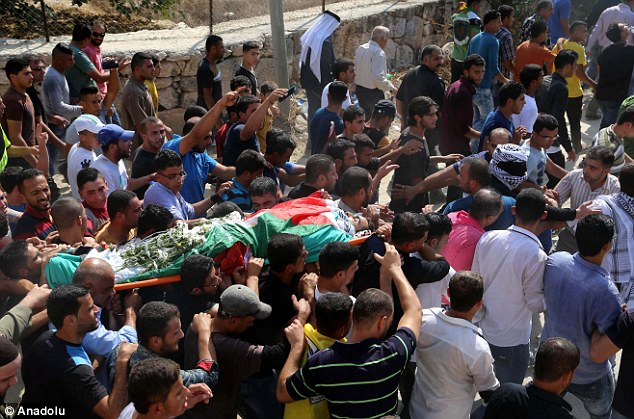 Palestinians carry the body of 27-year old Iyad el-Avavde killed by Israeli soldiers last week