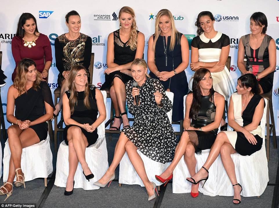 Sharapova (centre) answers a question during the Official Draw Ceremony prior to the end-of-season WTA Finals in Singapore
