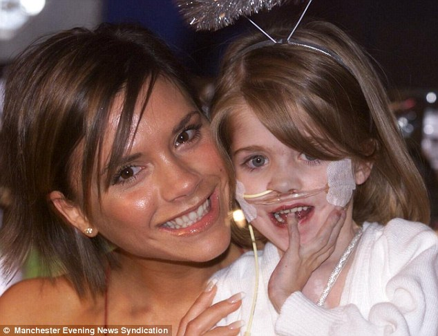 Cute: The then-six-year-old is seen in 2002 smiling alongside Victoria Beckham, whom she reduced to tears