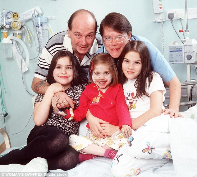 Family: Kirsty took her final breath surrounded by her parents, Lynn and Steve, and sisters, Zoe and Kim (all pictured above with Kirsty in 2001), at Manchester Royal Infirmary this morning, according to the Kirsty Club