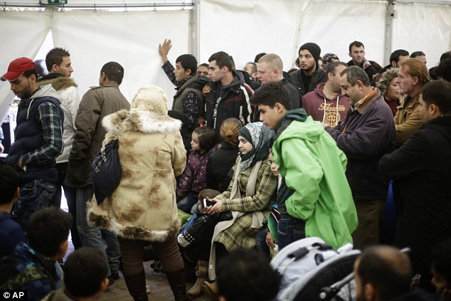 Migrants wait at the central registration centre   in Berlin. Germany's security services have expressed concern that the country is 'importing' Islamic extremism by allowing so many refugees into the country