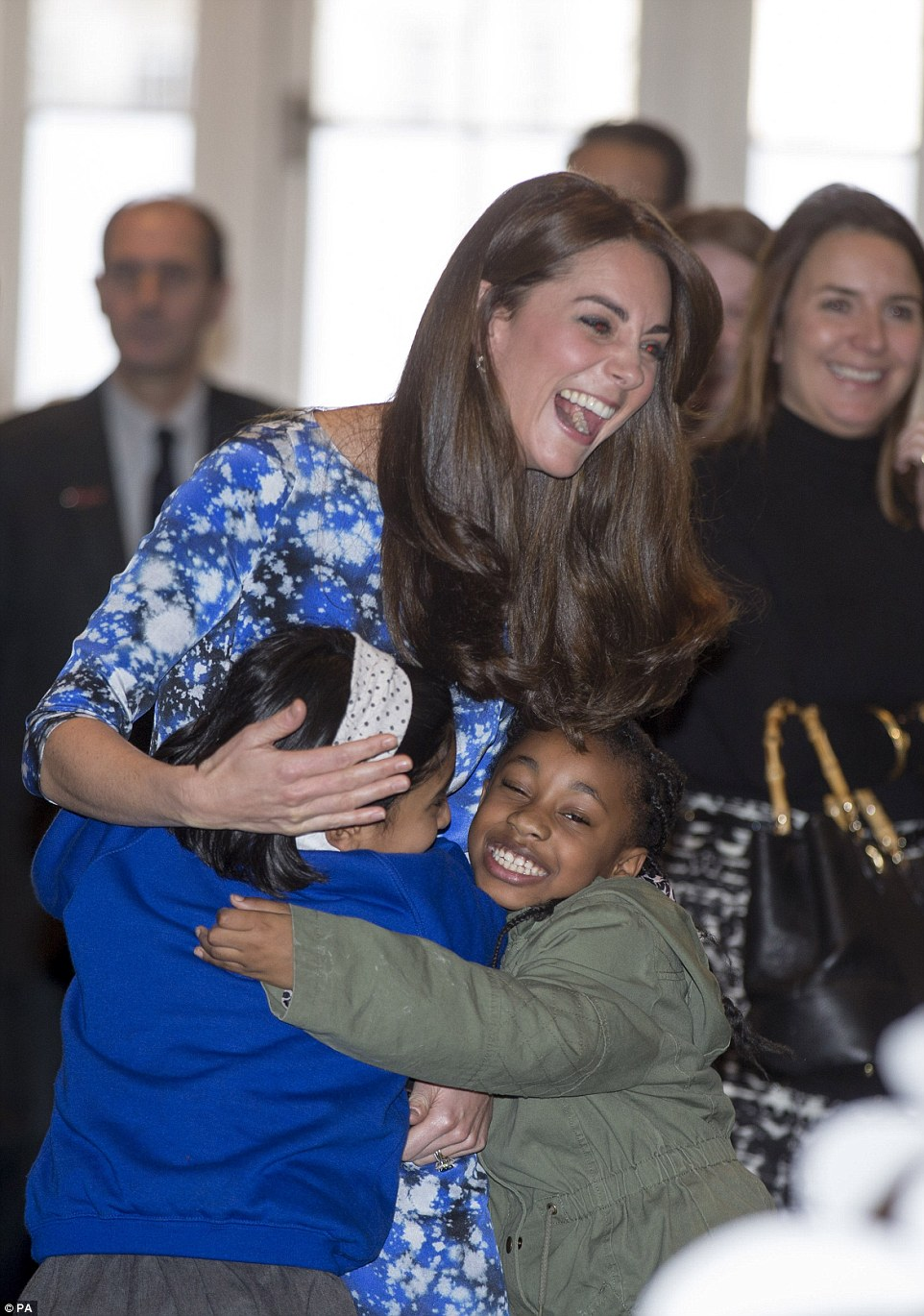 The Duchess of Cambridge proved to be a hit as she was showered with hugs from children during the visit