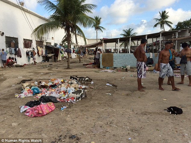Squalid: Garbage builds up in one of Pernambuco's prisons which are rife with disease due to unsanitary conditions