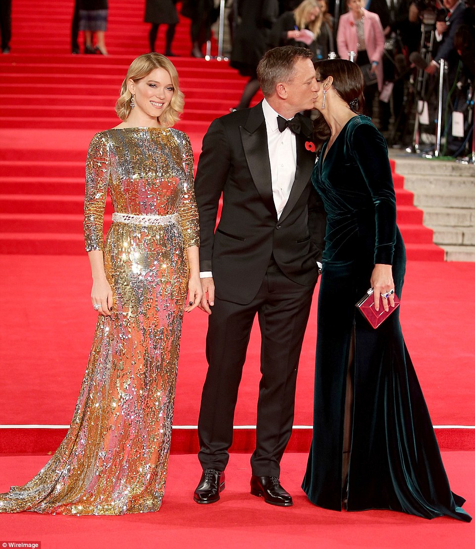 Getting on the action: Craig gave Bellucci a kiss on the cheek as Seydoux worked the cameras