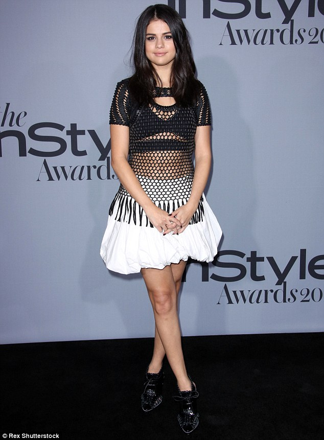 Brave face: Selena Gomez looked stunning at the InStyle Awards in Los Angeles on Monday, later admitting that she was having a hard time following the death of her friend Jake Bailey