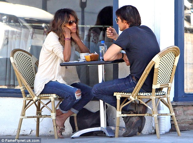 Serious: Seen here in August deep in conversation as they had breakfast at La Conversation in West Hollywood