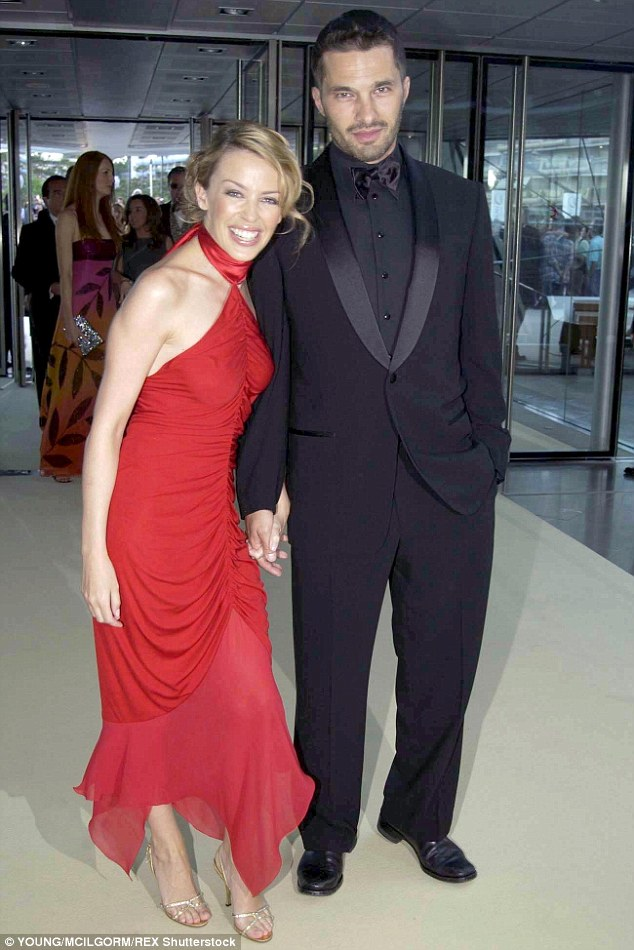His lady in red:From 2003 to 2007 he was with singer Kylie Minogue; here they are seen in 2003
