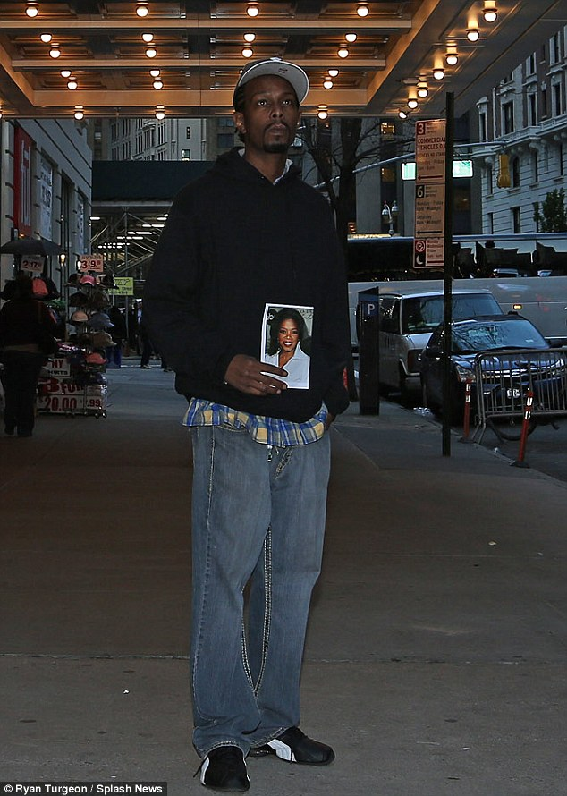Mitchell (pictured) said he charmed Oprah by offering her a Diet Coke on a film set, and she offered him a job as her 'personal bodyguard' before asking his mother Eva if she could adopt him