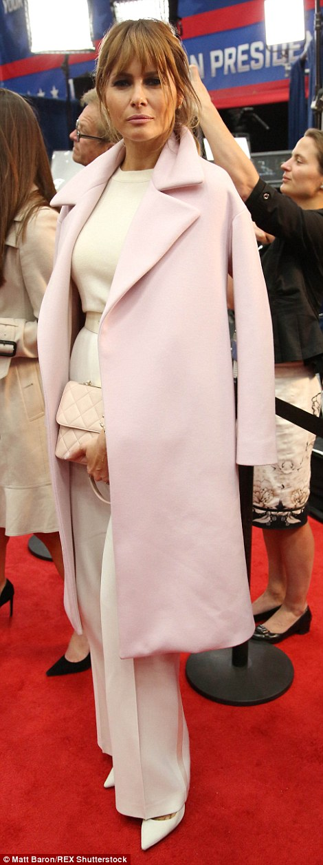 Dressed to the nines: Melania, 45, looked exceedingly glamorous in a white trouser suit and pale pink coat