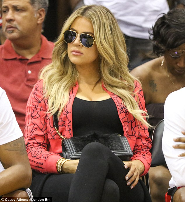 Back with her beau: Khloe Kardashian is back together with James Harden. The 31-year-old Keeping Up With The Kardashians star flew to Houston  to watch his NBA match on Wednesday, a source told DailyMail.com; here she is seen taking in a Rockets game in August